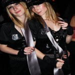 Picture of Twins dressed in matching cop outfits